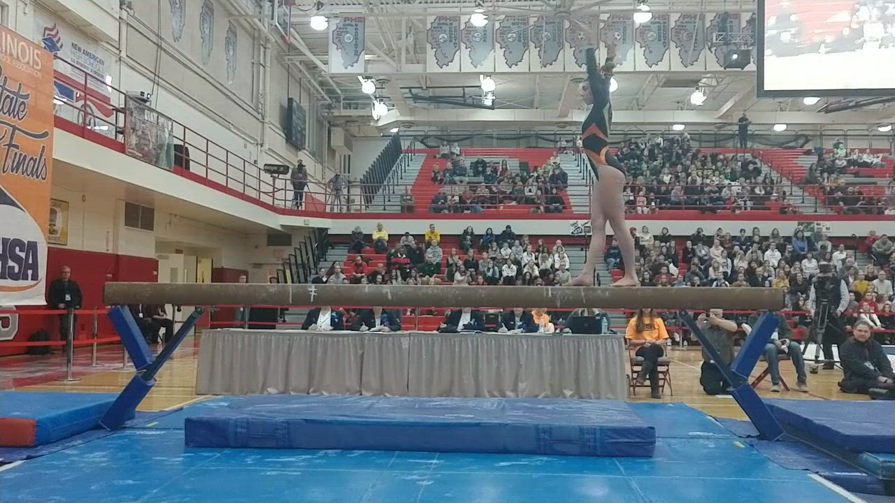 Maddie Kees on the beam