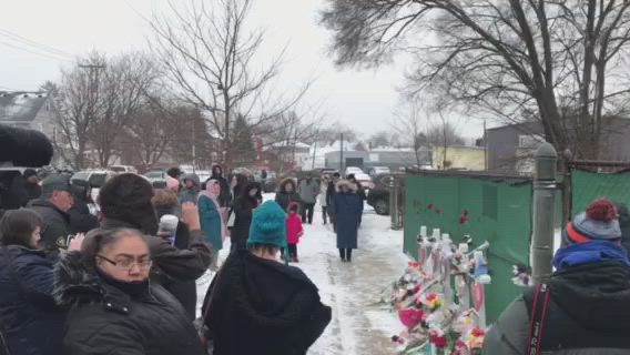 A crowd gathered outside of the Henry Pratt facility near downtown Aurora on Sunday, to take part in a prayer vigil following a mass shooting on Friday.