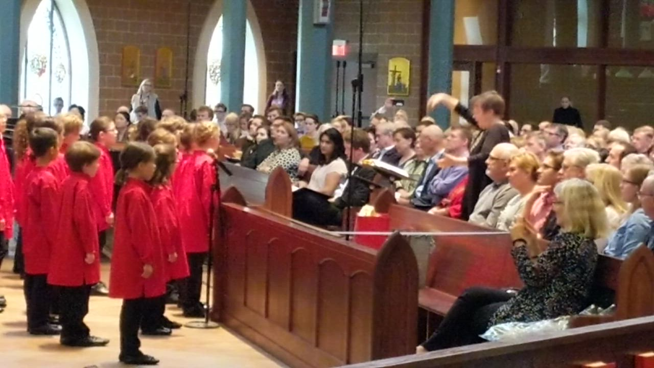 Anima Artistic Director Emily Ellsworth directs the Glen Ellyn Children's Chorus during their spring concert, Journey, on May 20 at St. Michael Catholic Church in Wheaton. Ellsworth is retiring after 21 years as artistic director of Anima.