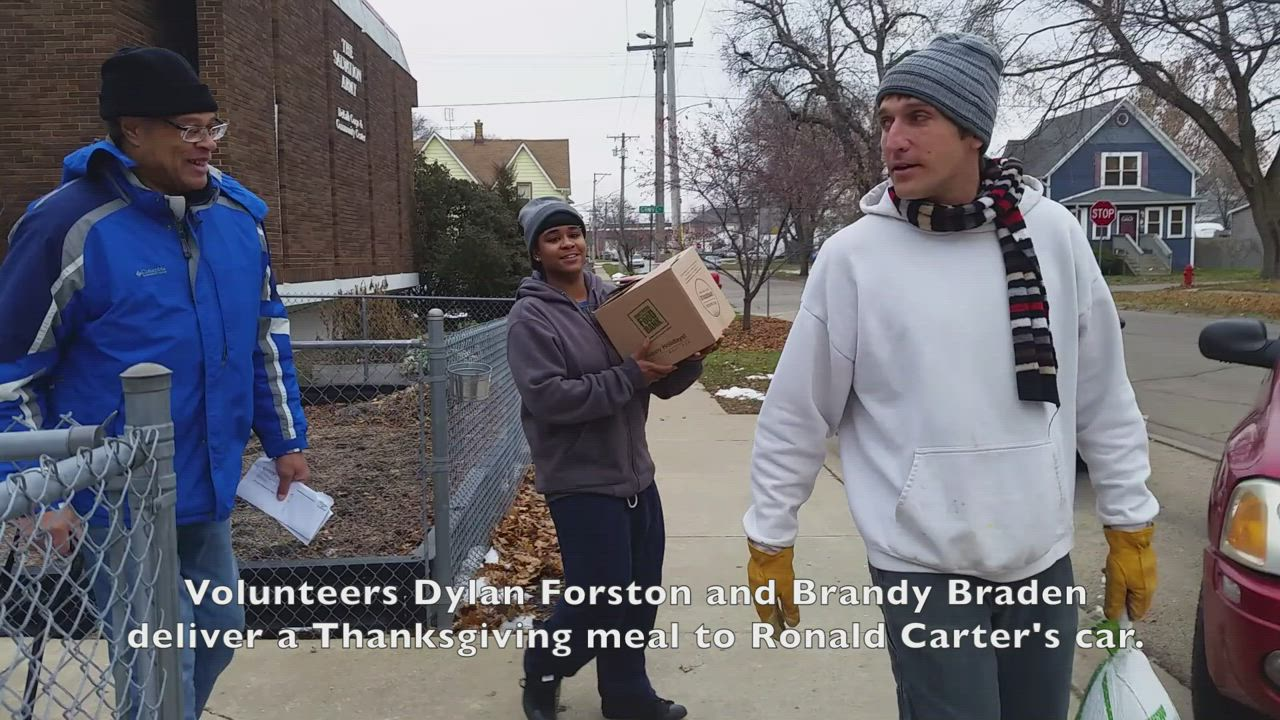 Salvation Army volunteers deliver free Thanksgiving meals to vehicles of DeKalb residents, who express their gratitude.